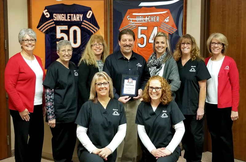 Orthodontist Dr. Dennis Flanagan and staff pose with their 2017 What Rocks award